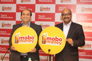 Mr Jagdish Mitra,Chief Strategy & Marketing Officer, Head of Growth Factories, Tech Mahindra Ltd (Right) unveiling MoboMoney along with Mr Vivek Chandok,Head - Consumer Businesses, Tech Mahindra Ltd. (Left)